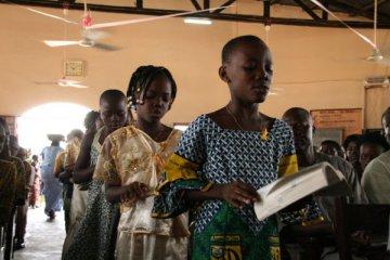 Beninese children celebrating Scripture in their church